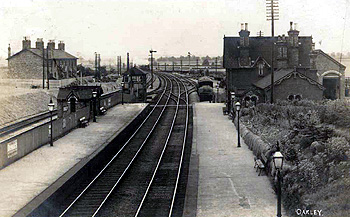Oakley Station about 1900, with Railway Cottages on the left [Z1130/85]